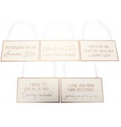 a variety of comical scripted plaques with added ribbon hangers