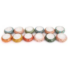 Morroccan design jewel tone Ceramic tealight holders. Includes tealights