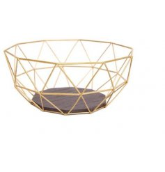 Golden bowl in geometric wire design with wooden base