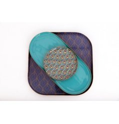 Three metal plates - square, oblong and round - from the peacock giftware range. Largest plate 21 cm square