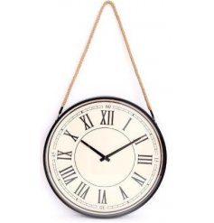 Traditional style cream wall clock hung from rope handle. Measures approx 44 cm