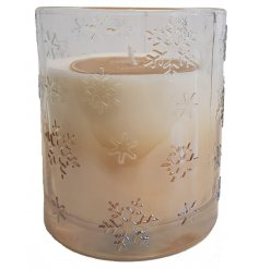 A lusciously scented Amber Vanilla Wax fills out this beautifully decorated snowflake candle pot