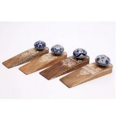 this assortment of natural wooden door wedges also feature pretty patterns and blue toned knobs on top
