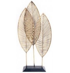 3 golden metal leaves arranged standing upright and overlapping each other. Approx size 50 x 24 x 9 cm
