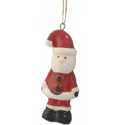 An cute little hanging ceramic Santa complete with a traditional inspired colouring