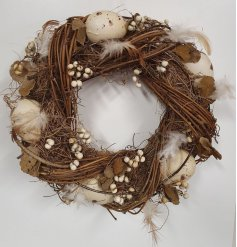 A rustic round wreath inspired to look like a delicate birds nest