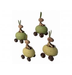 A mix of 2 wooden rabbits, each driving a yellow or green polka dot egg car. A unique seasonal decoration and gift item