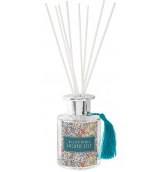 this reed diffuser also displays a gorgeous Golden Lily print and matching tassel finish!