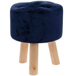 Glamorous navy blue velvet stool measuring 38cm high