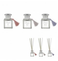 Elegant silver reed diffusers styled to resemble traditional perfume atomiser