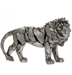 A beautiful posed Lion ornament set with a rustic silvered Natural World decal