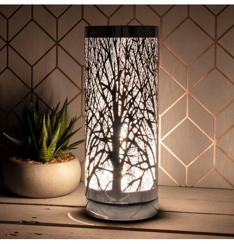 An elegant desire aroma lamp with a woodland design in silver. This lamp is touch operated with 3 brightness levels.