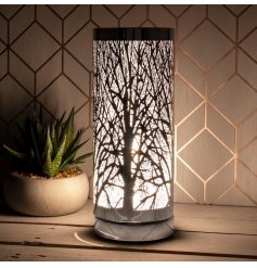 A unique and stylish table lamp with a bold branch design pattern. A luxury living interiors item for the home.