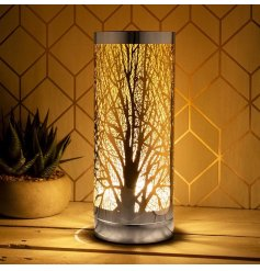 this warm glowing LED touch lamp will tie in with almost any themed home space