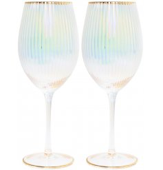 Glamorous pair of wine glasses with opalescent tint and ribbed texture