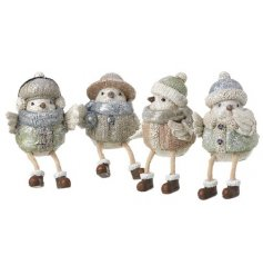 4 different shelf sitter figures of birds wearing winter clothing