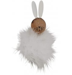 A charming wooden rabbit decoration with a cute painted face, pointed ears and a fluffy feather body.