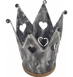 A rustic metal crown with heart details and a distressed finish.