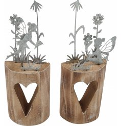 A mix of 2 charming fairy ornaments featuring a silhouette fairy garden set upon a wooden block with heart feature.