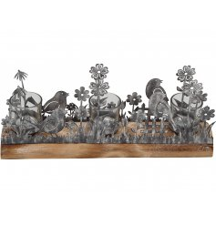 A charming metal bird and flower garden t-light holder with 3 votives. Set onto a rustic wooden base.