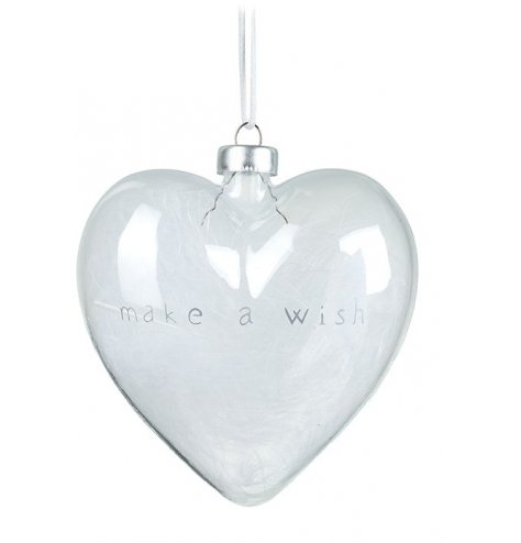 A chic heart shaped glass hanging decoration, which is filled with white feathers.