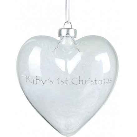 A small and delicate glass heart bauble set with a silver scripted decal and filled with white fluffy feathers