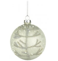 Neutral toned glass bauble with stylised design of tree in snow