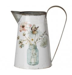 A pretty vintage metal jug decorated with a watercolour bouquet in glass jar.