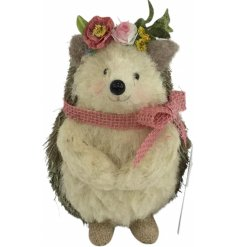 A gorgeous hedgehog decoration with a pretty in pink floral head crown and bow.