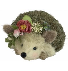 A pretty hedgehog decoration dressed with pretty spring flowers in pastel colours.