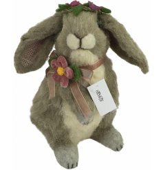 An adorable grey toned bunny complete with a pretty pink organza bow and florally extras