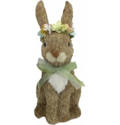 A seagrass bunny with a pretty floral crown and bow tie