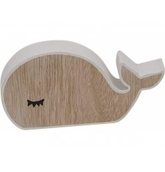 A cute little natural wooden Whale decoration with an added white edging