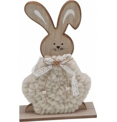 An adorable little wooden bunny covered with a soft woollen coating