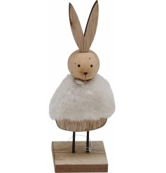 A small wooden bunny dressed up in a faux fur coat