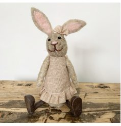 An adorable little woollen rabbit decoration dressed up in her favorite party dress and matching head piece