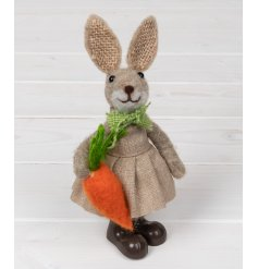 All dressed up in her favourite frock, Penny also features a green bowtie and hessian fabric ears