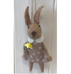 A cute little hanging woollen bunny decoration dressed up in a cute printed frock