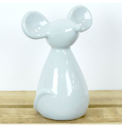 A chic and contemporary grey mouse figure with large ears, cute nose and curled tail.