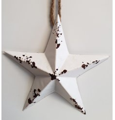 Vintage white metal 5 pointed star ornament with rust detail on wear points.