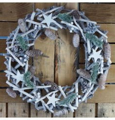 A large decorative Wreath made up of clustered Twigs, Berries, Pine Leaves and Stars