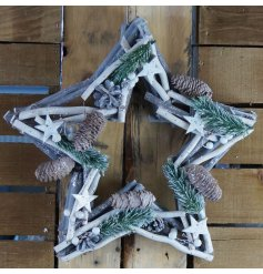 This contemporary star shaped wreath is made from natural materials and features pine cone embellishments