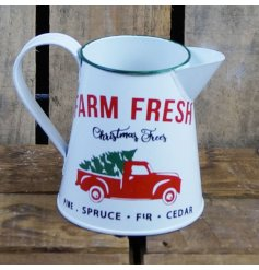 A white zinc decorative jug featuring a festive motive and distressed finish