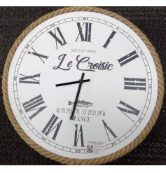 Classic nautical clock, framed in jute rope, with roman numerals. Measures approx 36.5 cm