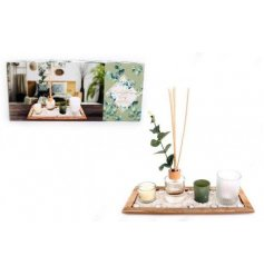 A charming little gift set including sweetly scented candles and a diffuser