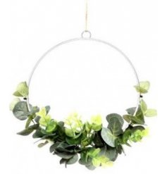 A beautifully simple half built wreath with delicate entwined Eucalyptus leaves