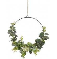 A stunning black metal wreath decorated with artificial eucalyptus. Complete with a rustic jute string hanger.