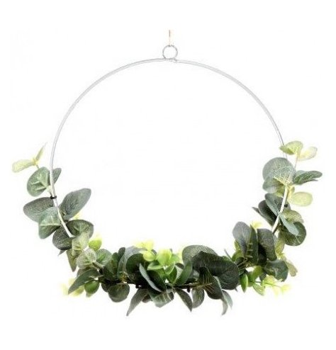 A contemporary Christmas wreath with a metal hoop and artificial eucalyptus foliage.