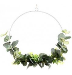 A stunning silver metal wreath decorated with artificial eucalyptus. Complete with a rustic jute string hanger.
