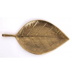Attractive gold coloured metal leaf, use to store car keys, trinkets etc. Approx 31.5 cm long.